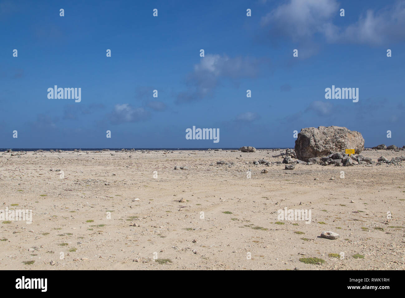 This large rock was washed ashore onto the coast of tropical island Bonaire in the caribbean 3000 years ago by a Tsunami Stock Photo