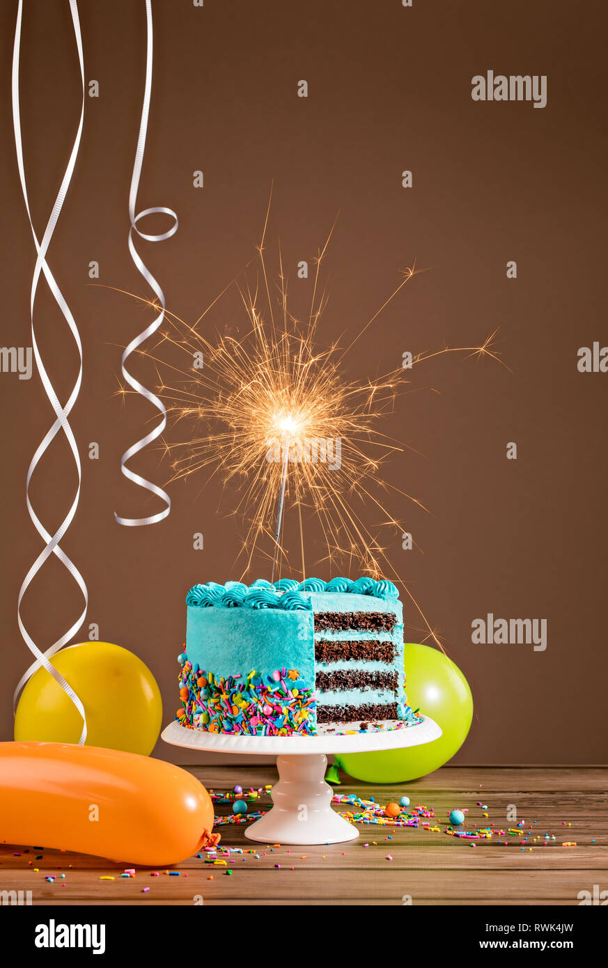 Surprising Blue Birthday Cake With Sparkler And Colorful Balloons Stock Photo Funny Birthday Cards Online Hendilapandamsfinfo