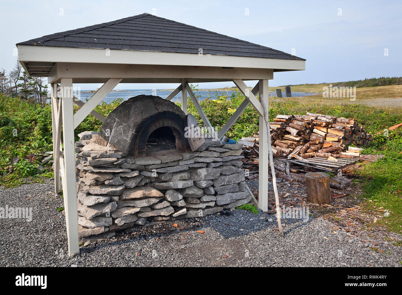 Outdoor, wood-fired, brick-and-stone bread oven on a stone