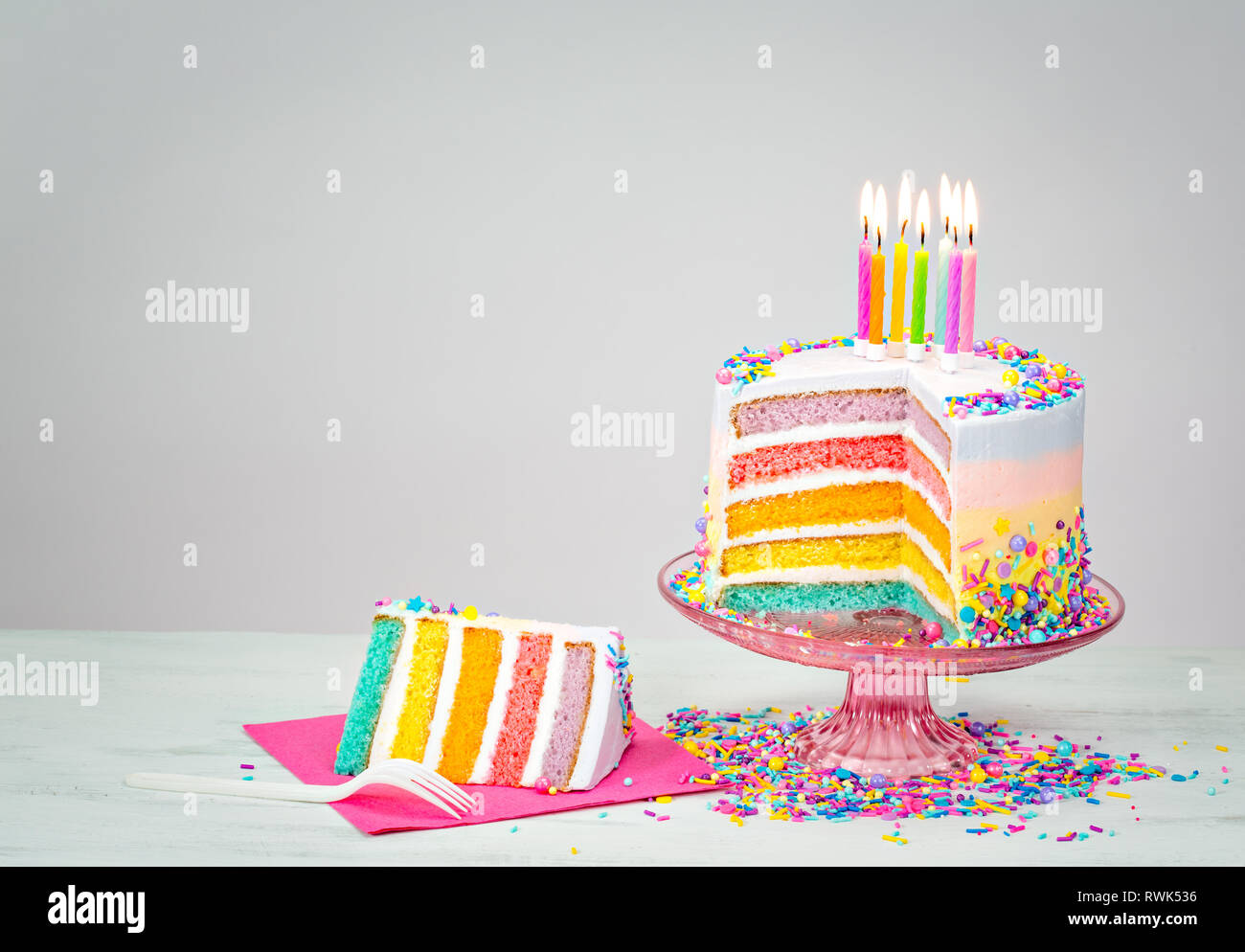 Outstanding Colorful Rainbow Layered Birthday Cake With Lit Candles And Birthday Cards Printable Nowaargucafe Filternl