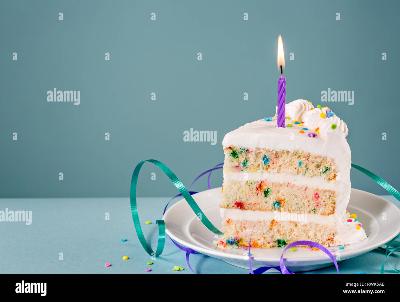 Peachy Slice Of Birthday Cake With A Lit Candle And Ribbons Over A Blue Personalised Birthday Cards Paralily Jamesorg