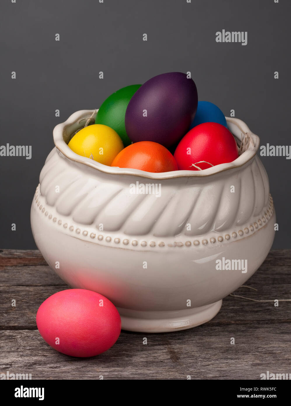 Rainbow Colored Easter Eggs In Bowl On A Grey Background Stock Photo Alamy