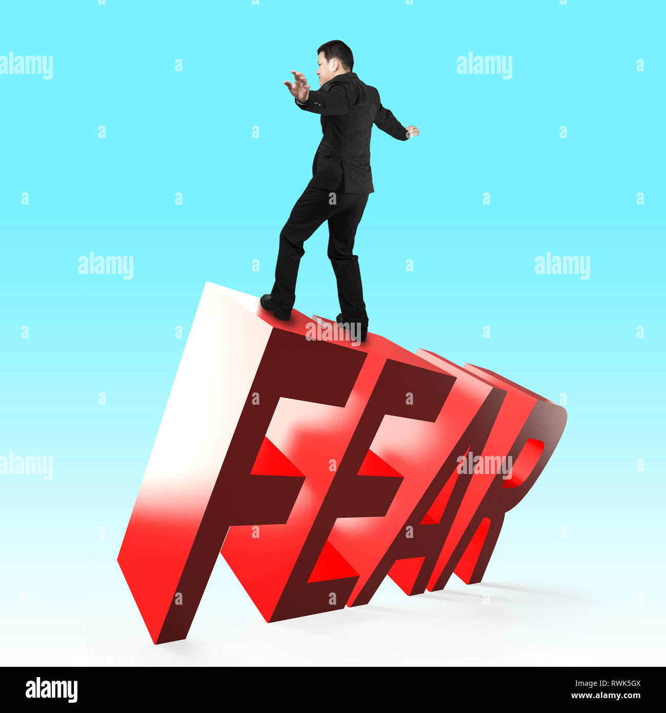 Businessman balancing on 3D red FEAR word falling. Concept of courage, overcoming fear and adversity. - Stock Image