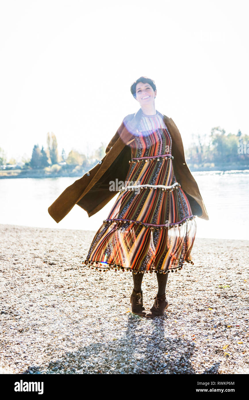 Woman twirling by Rhine River, Strandbad, Mannheim, Germany - Stock Image