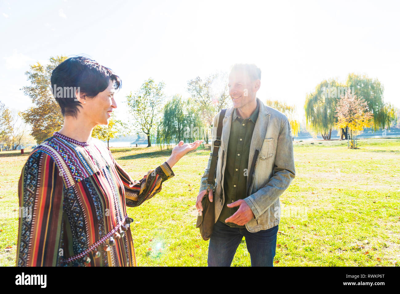 Couple teasing each other in park, Strandbad, Mannheim, Germany - Stock Image