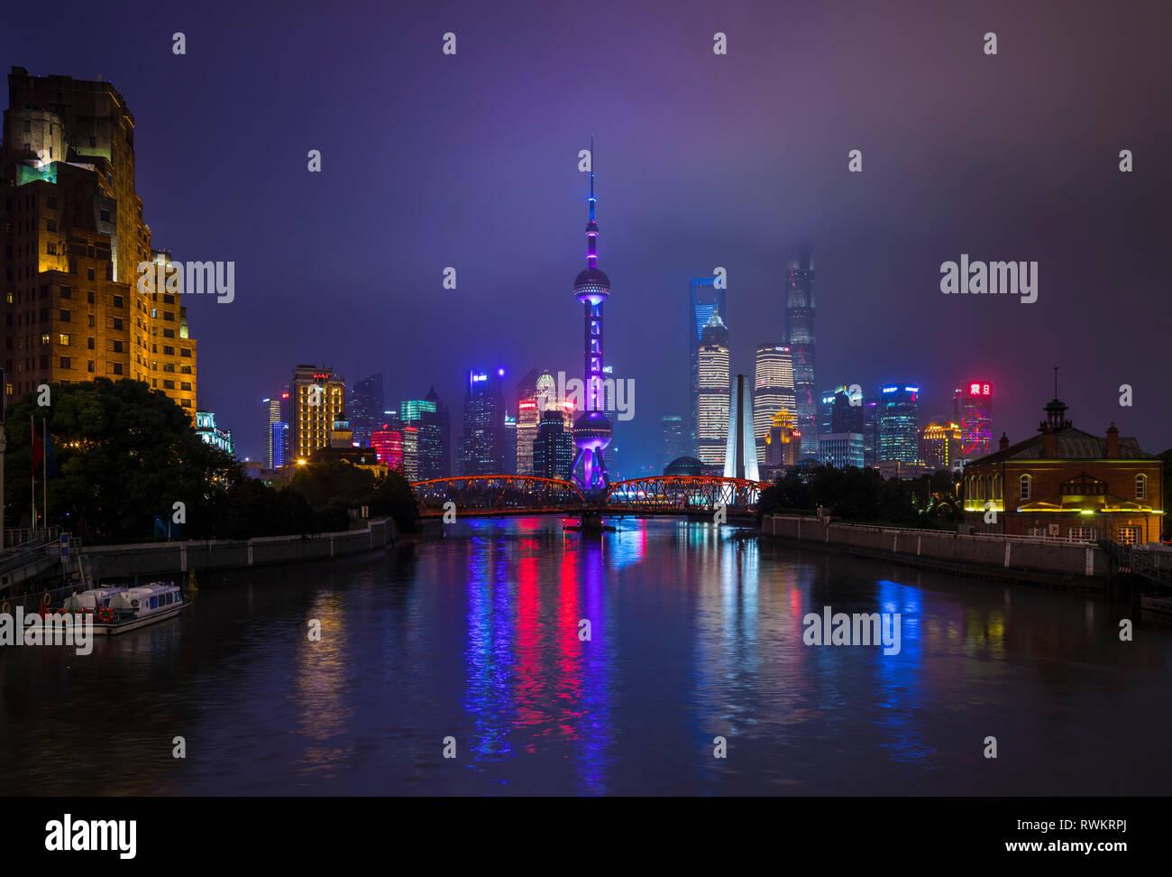 Pudong skyline and Waibaidu Bridge over Huangpu river  at night, Shanghai, China Stock Photo