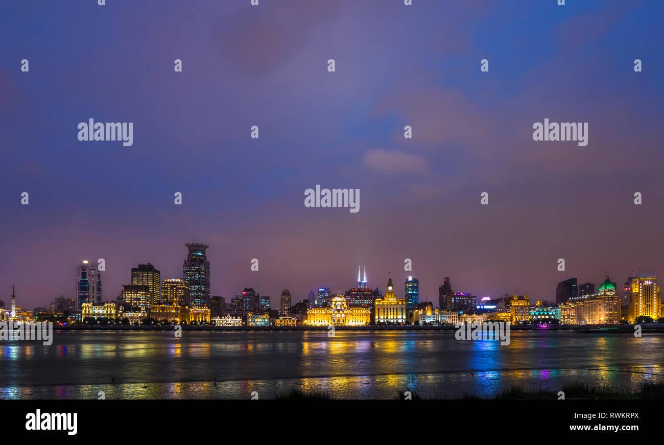 The waterfront and Bund skyline at night, Shanghai, China Stock Photo