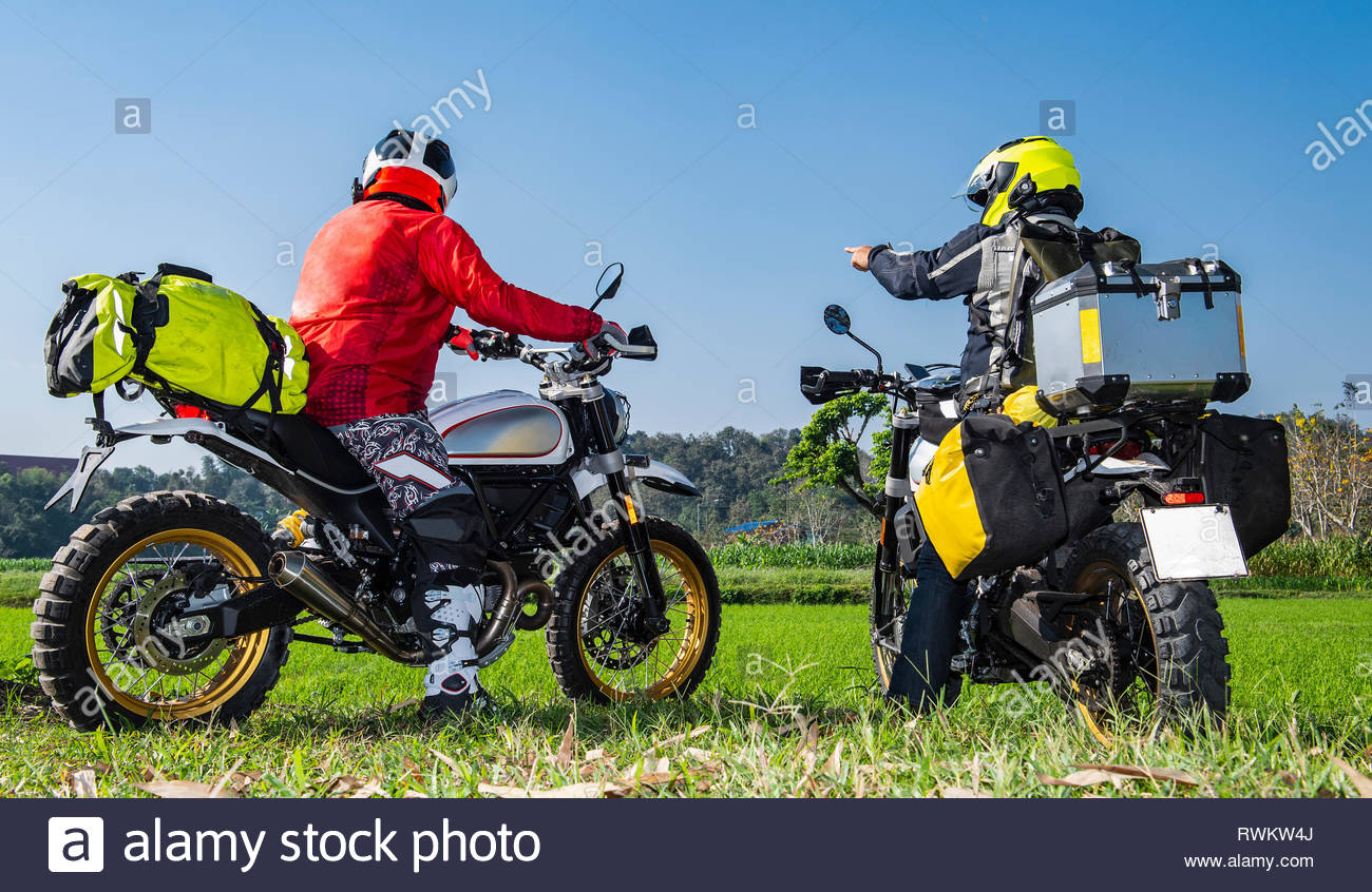 Bikers on scrambler discussing direction of track, Nan, Thailand Stock Photo