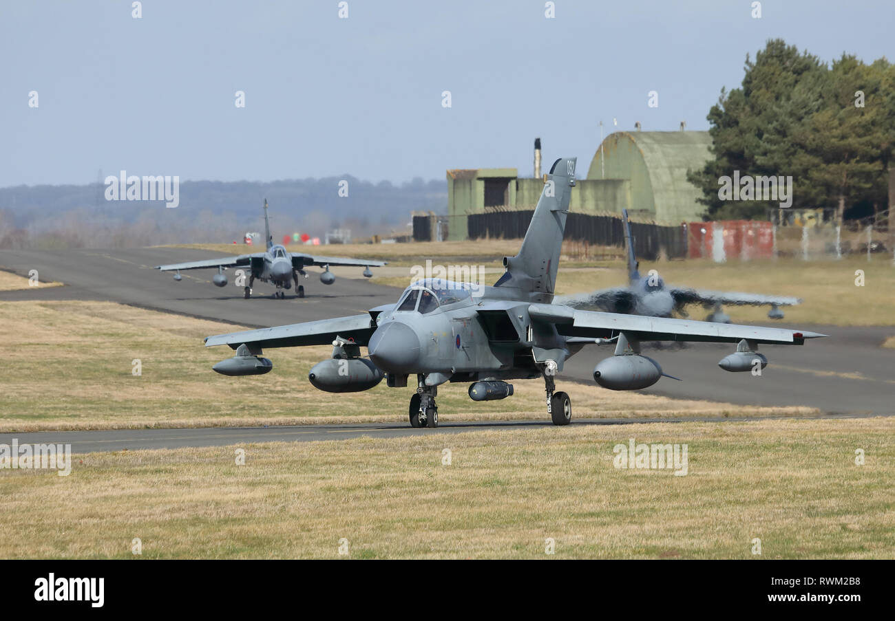 Three Tornado GR4 aircraft taxiing out to the runway at RAF Marham airbase, Norfolk, UK, during the farewell events before the type's retirement. - Stock Image