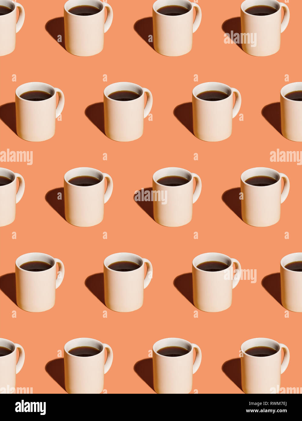 mugs of black coffee in rows against peach background stock photo alamy https www alamy com mugs of black coffee in rows against peach background image239546122 html