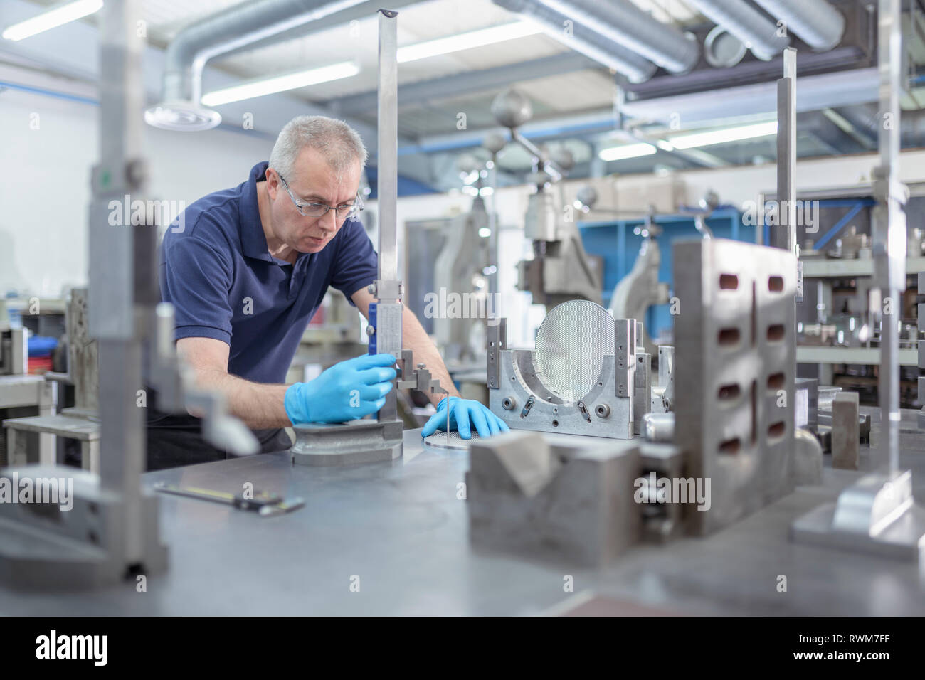 Engineer measuring part in engineering factory Stock Photo