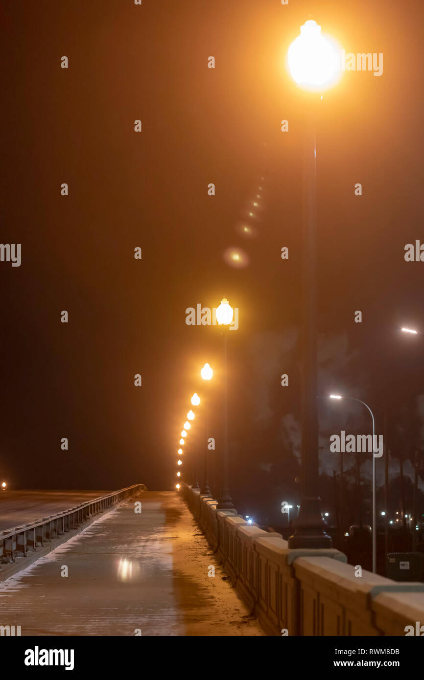 Detroit, Michigan - Street lights line a deserted bridge on a cold winter night. - Stock Image