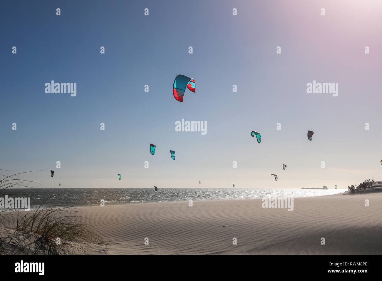 Group of kite surfers mid air over sea, Cape Town, Western Cape, South Africa - Stock Image