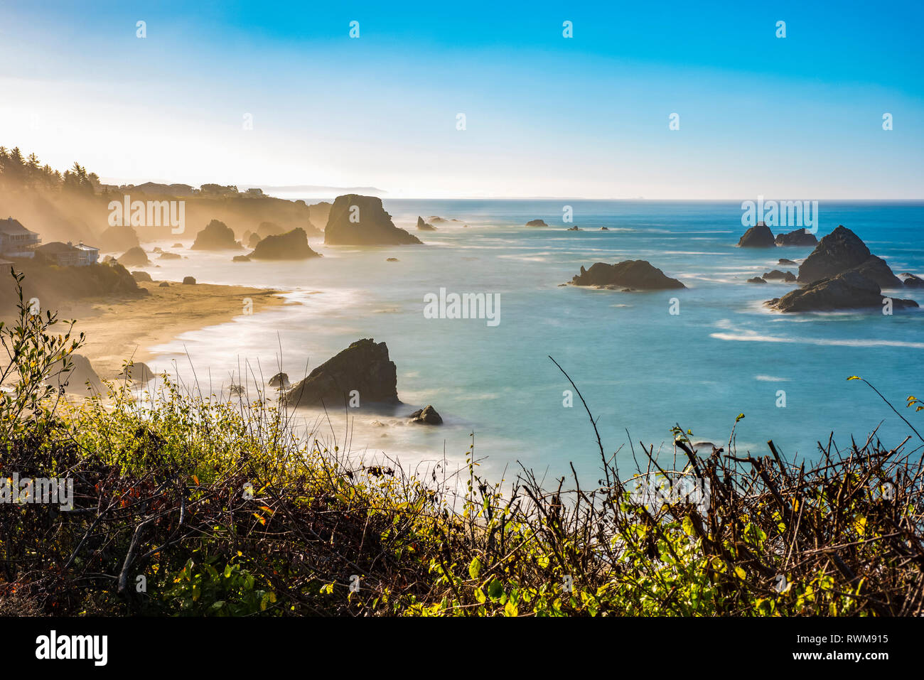 Morning mist rising from Harris Beach, near Brookings, Oregon. The rock formations add to the views looking out at the Pacific Ocean - Stock Image