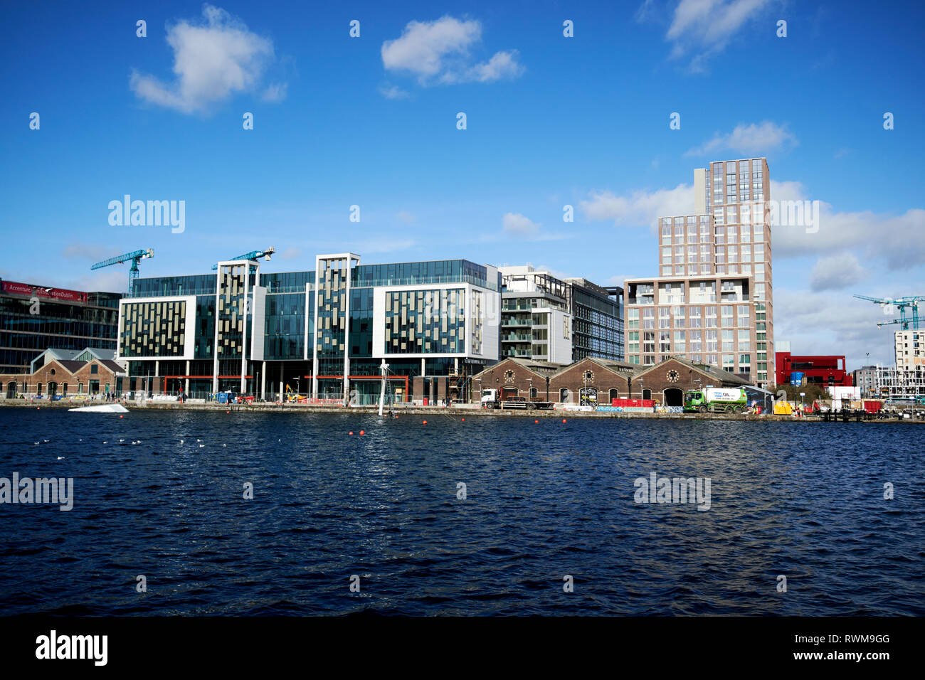 hanover quay and grand canal docks with the new airbnb warehouse headquarters and the reflector building Dublin republic of Ireland - Stock Image