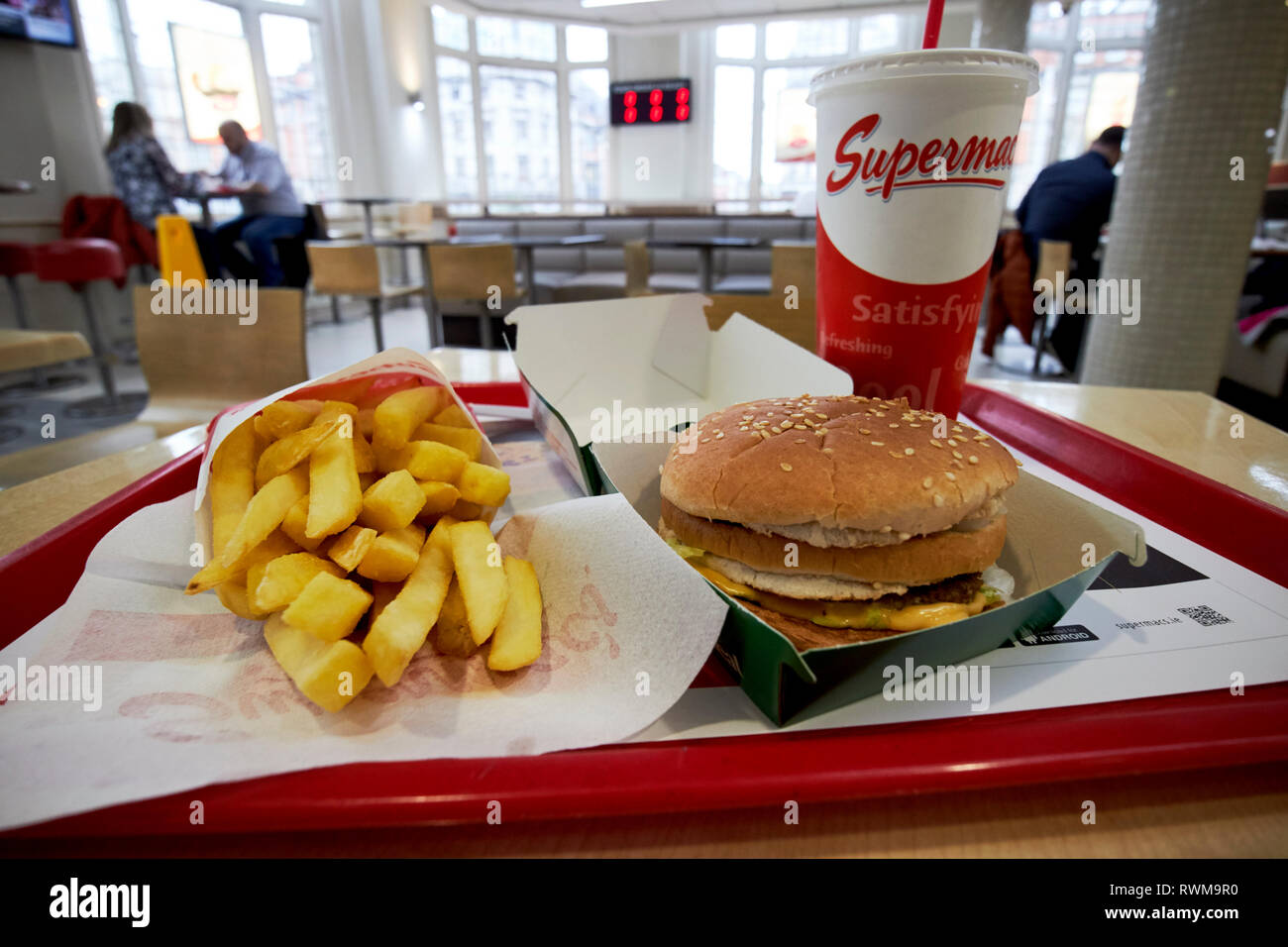 supermacs irish fast food burger chain mighty mac meal with fries and drink in their oconnell street store Dublin republic of Ireland - Stock Image