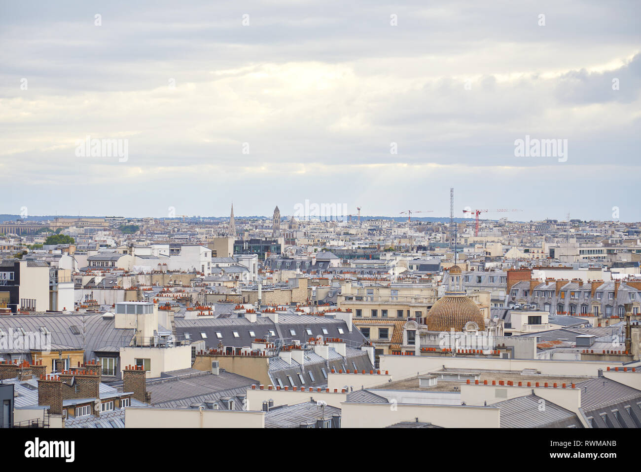 Paris rooftops view and skyline in a cloudy day in France Stock Photo