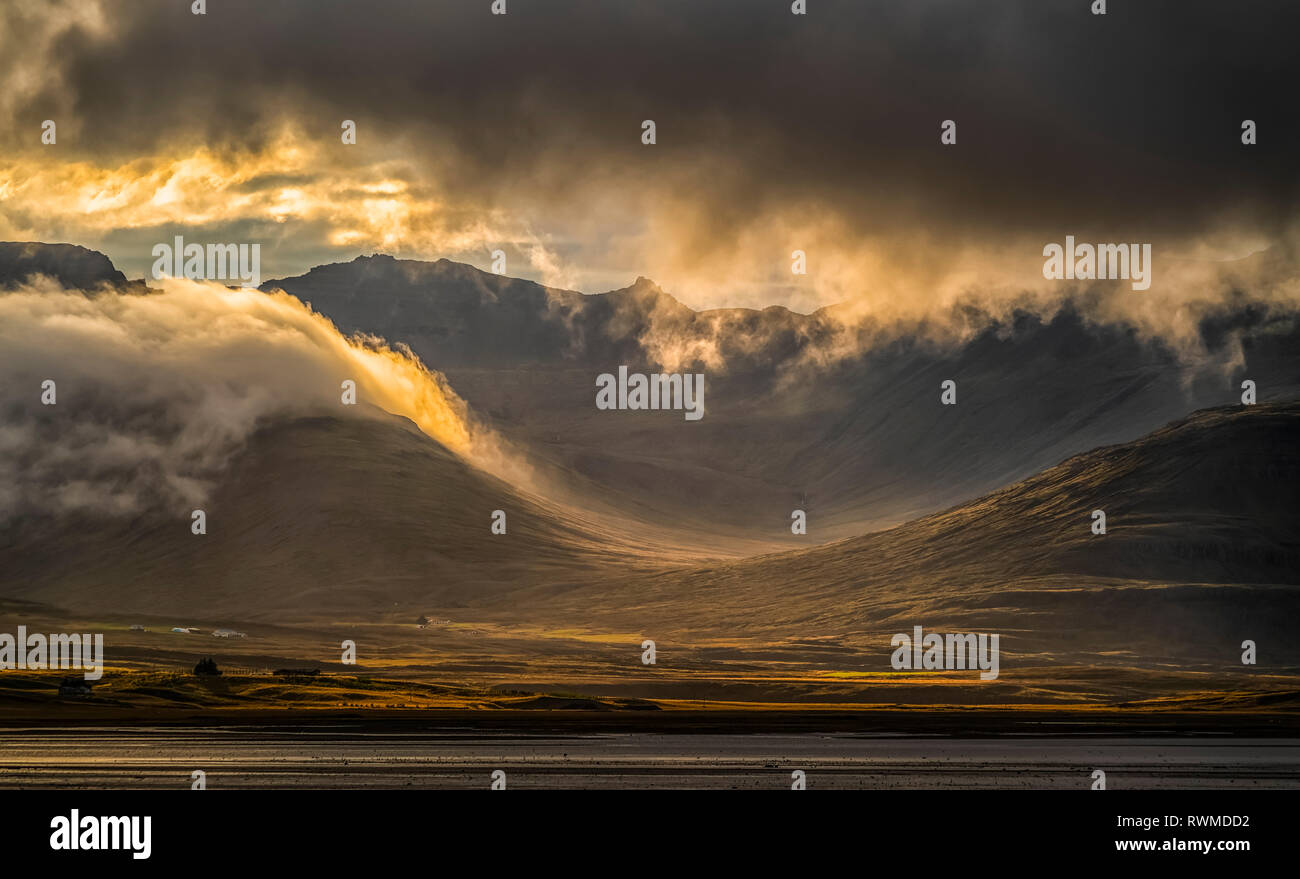 Beautiful sunset light over the East Fjords of Iceland; Iceland - Stock Image