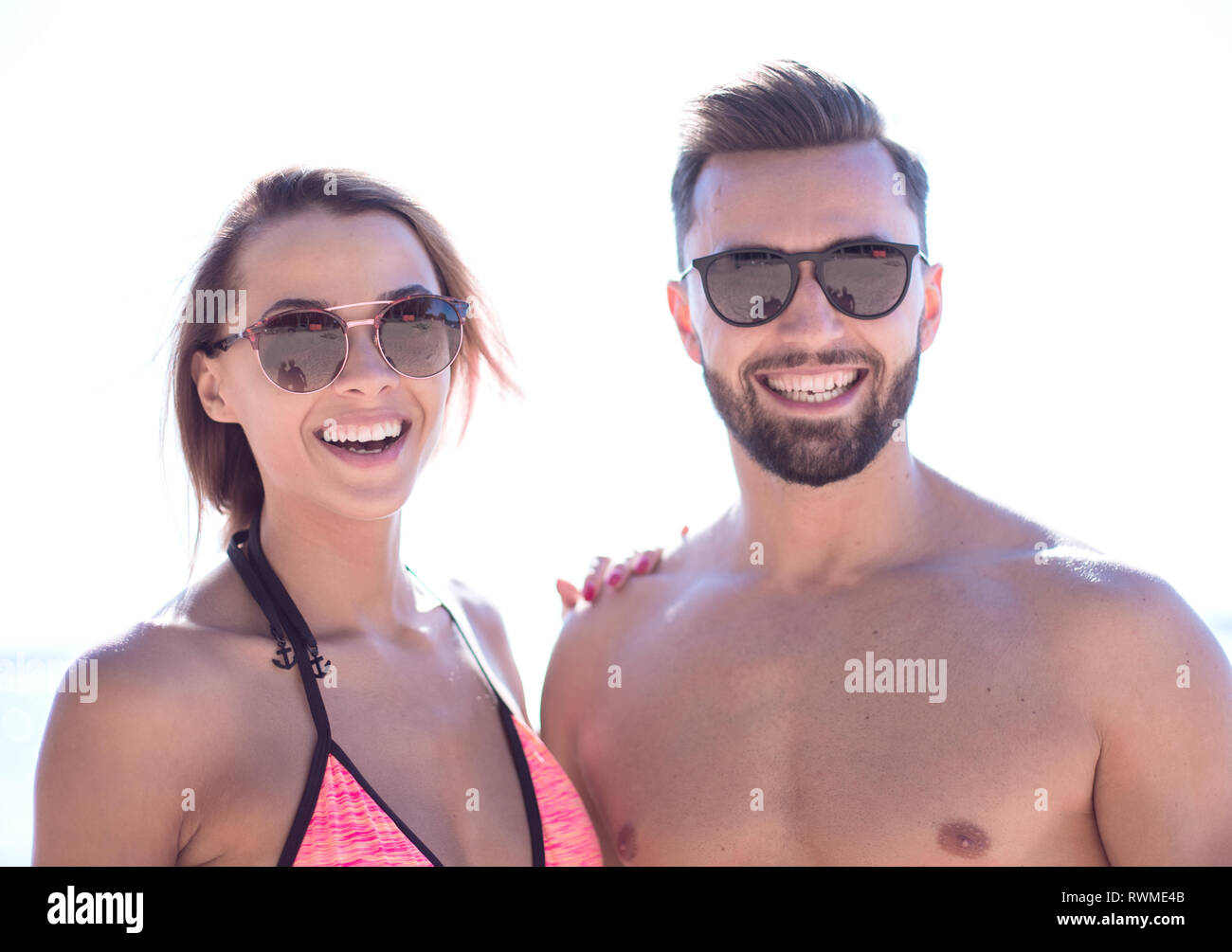 Handsome young man with young attractive woman  spending carefre - Stock Image