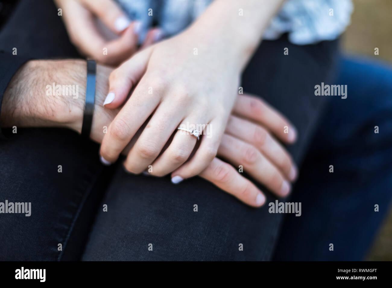 Engagement photo showing the engagement ring on the female's hand; Bothell, Washington, United States of America - Stock Image