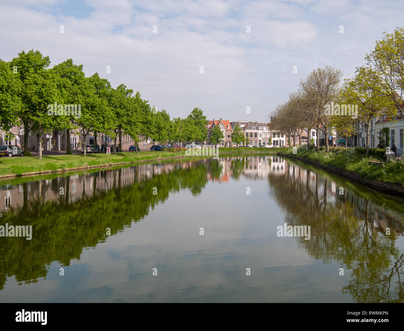 calm canal through Middelburg with trees and hedges on the sides on the island Walcheren, Zeeland, Netherlands Stock Photo