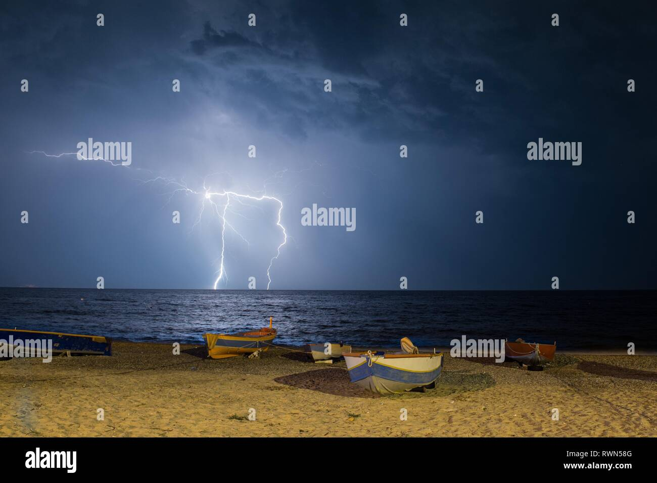A discharge of lightning. Following a strong disturbance traveling on the Ionian Sea, 24 June 2016, on the coast of Calabria and Basilicata, in southe - Stock Image