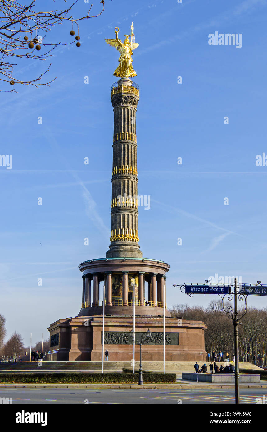 Berlin, Germany - February 17, 2019: The Victory Column with iIts viewing platform, a base of polished red granite, four blocks of sandstone - Stock Image