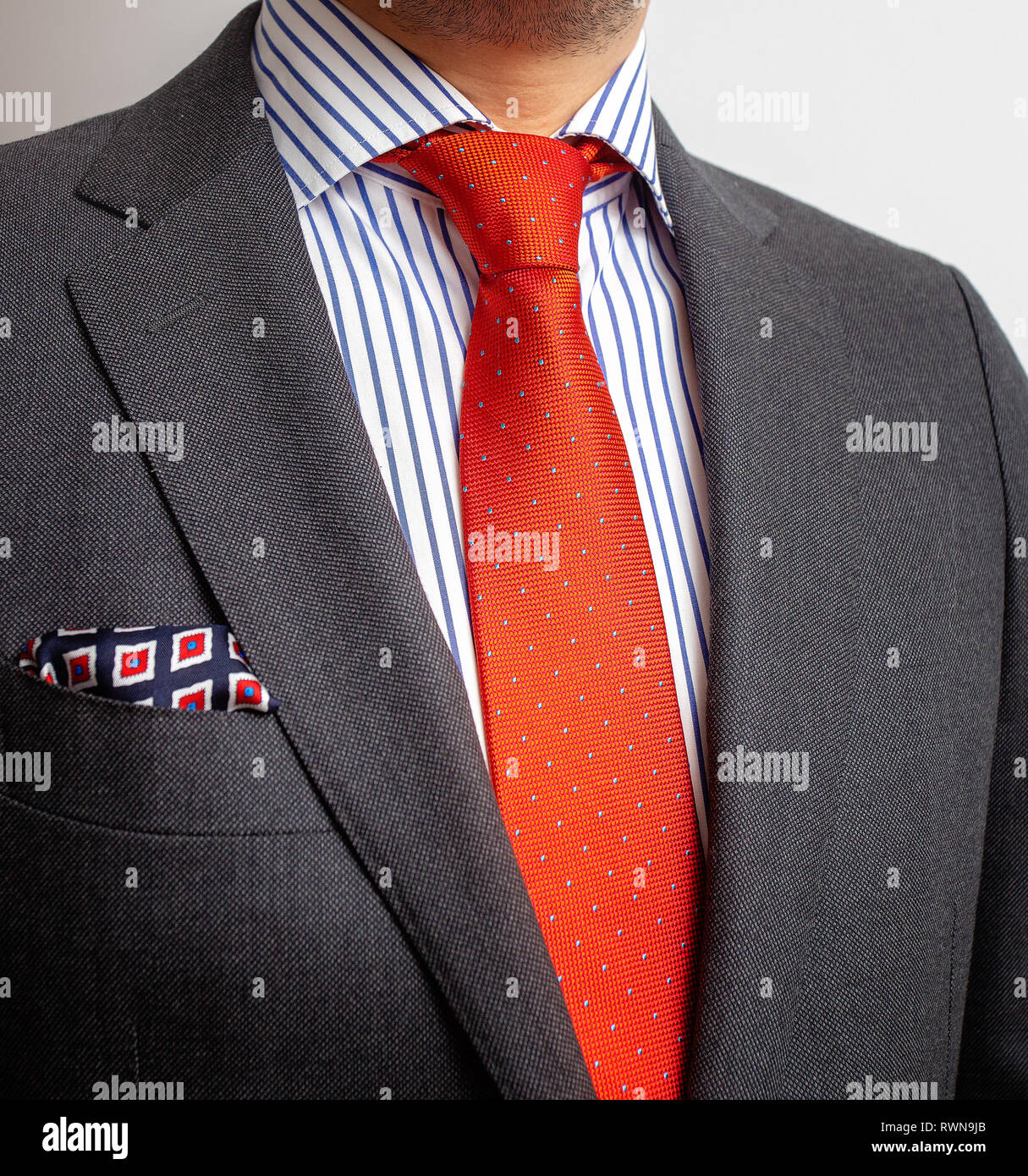 bf4ddc37e1c5 Business Power, Detail closeup - jacket men's, shirt with a orange tie and pocket  square