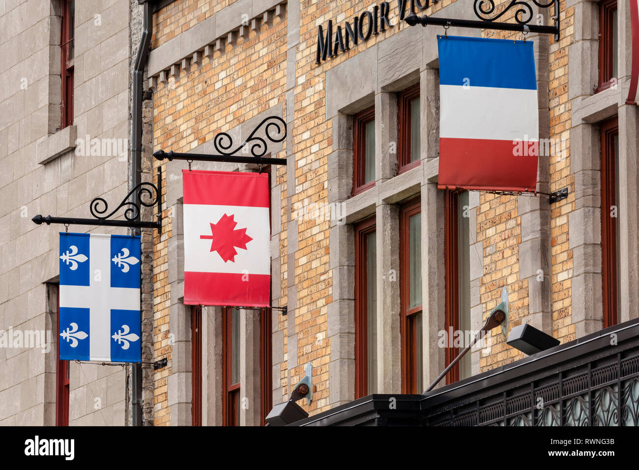 The National Flags Of Canada And France Hanging With The Provincial Flag Of Quebec In Quebec City Stock Photo Alamy