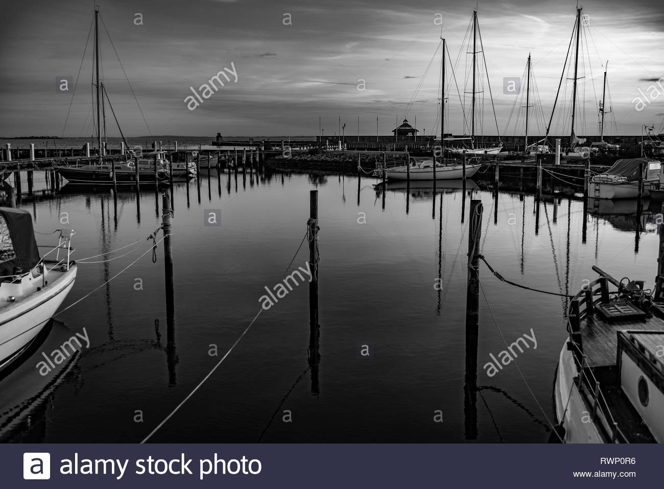 Windless evening, Lynaes harbour, Denmark - Stock Image