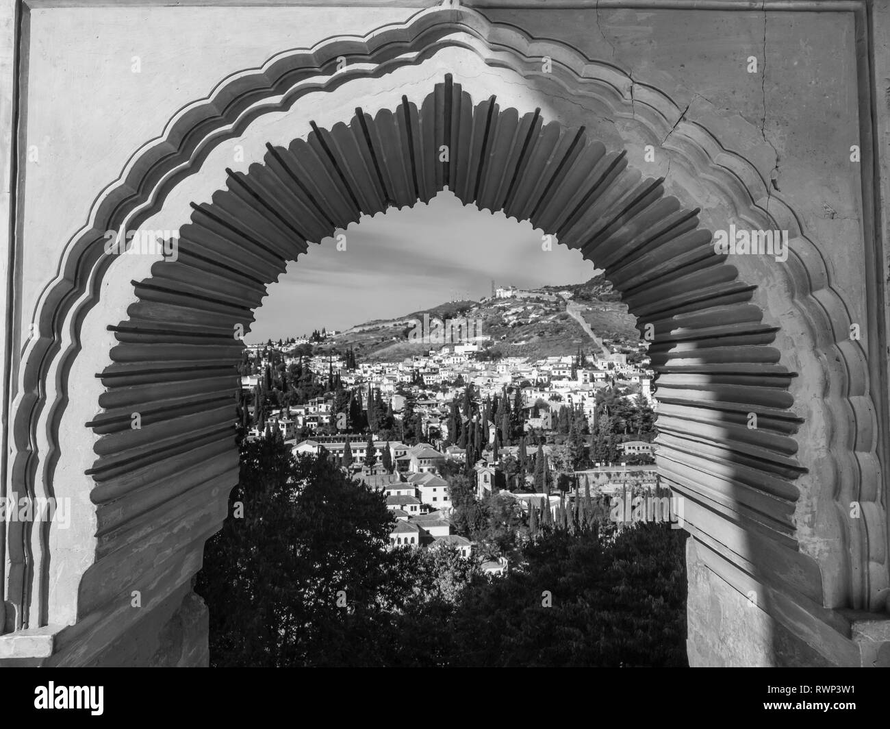 View of the town of Ubeda through a decorative archway; Ubeda, Jaen Province, Spain - Stock Image