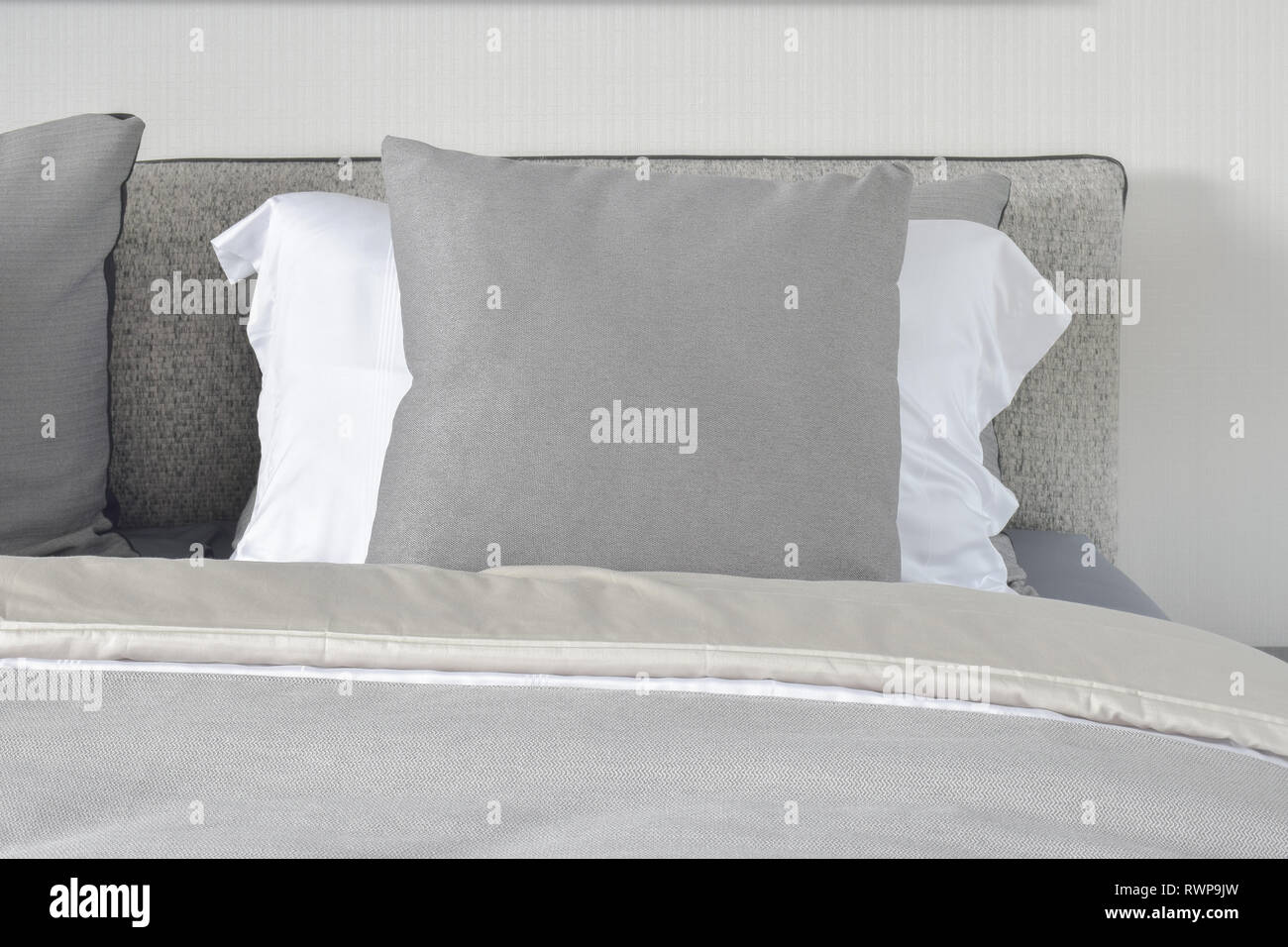 Gray And White Pillows On Bed In Gray Color Scheme Stock Photo Alamy