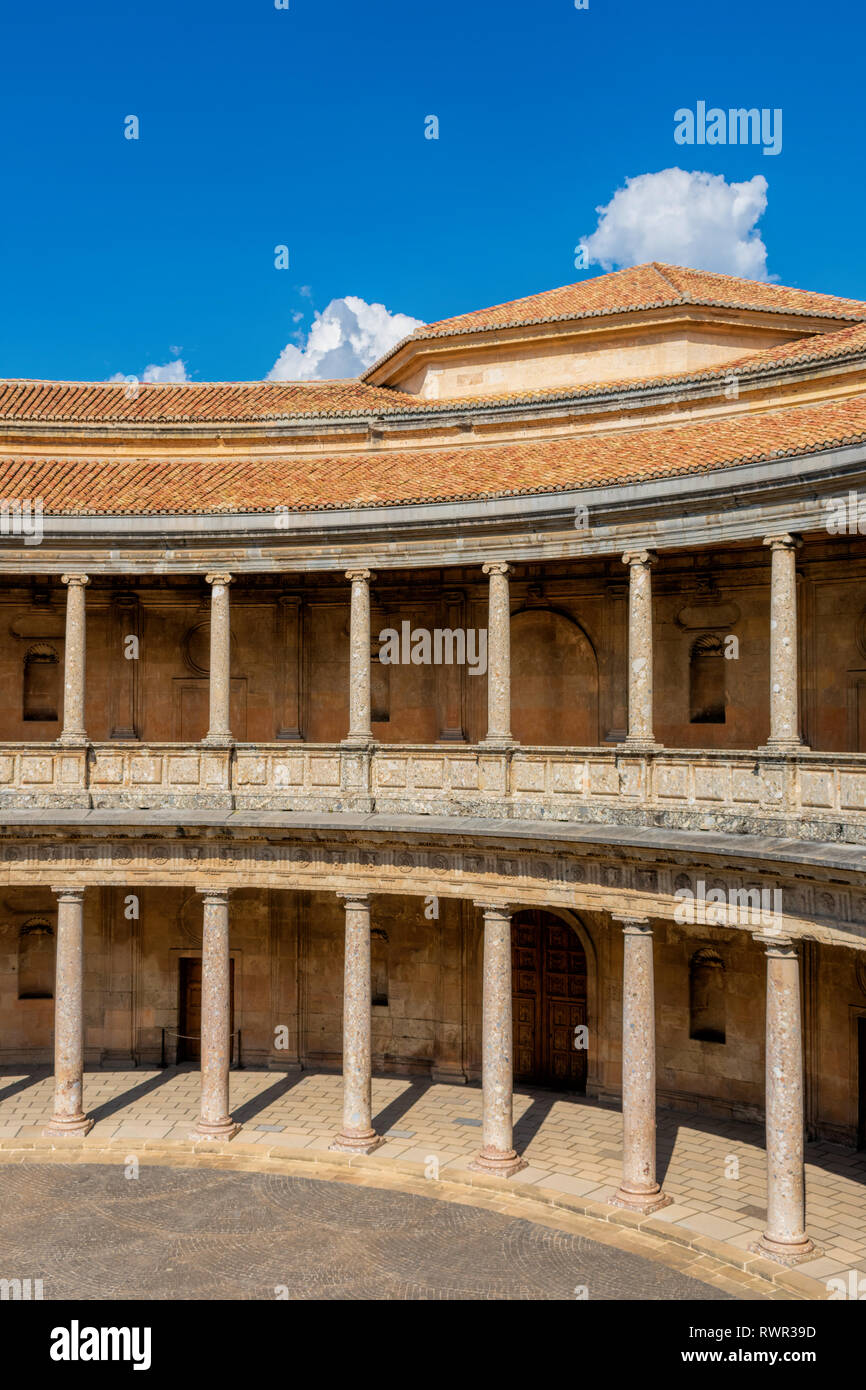 The circular patio of the Palace of Charles V inside the Nasrid fortification of the Alhambra Palace in Granada - Stock Image
