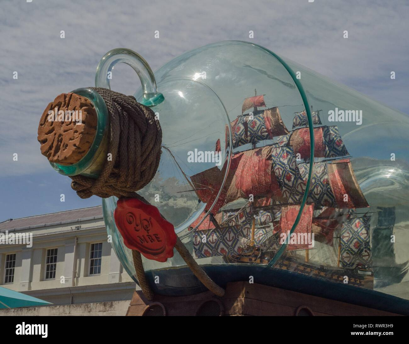 A monument depicting Lord Nelson's ship, HMS Victory, stands outside the National Maritime Museum in Greenwich, London, England. Stock Photo