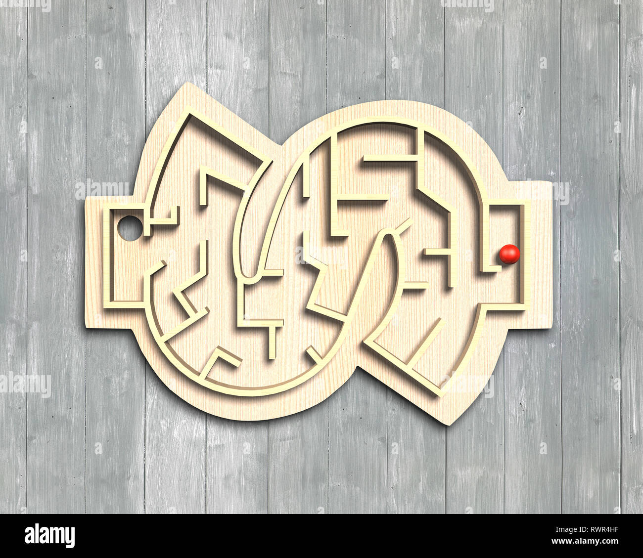 Maze ball game in money shape box, on wooden background. - Stock Image