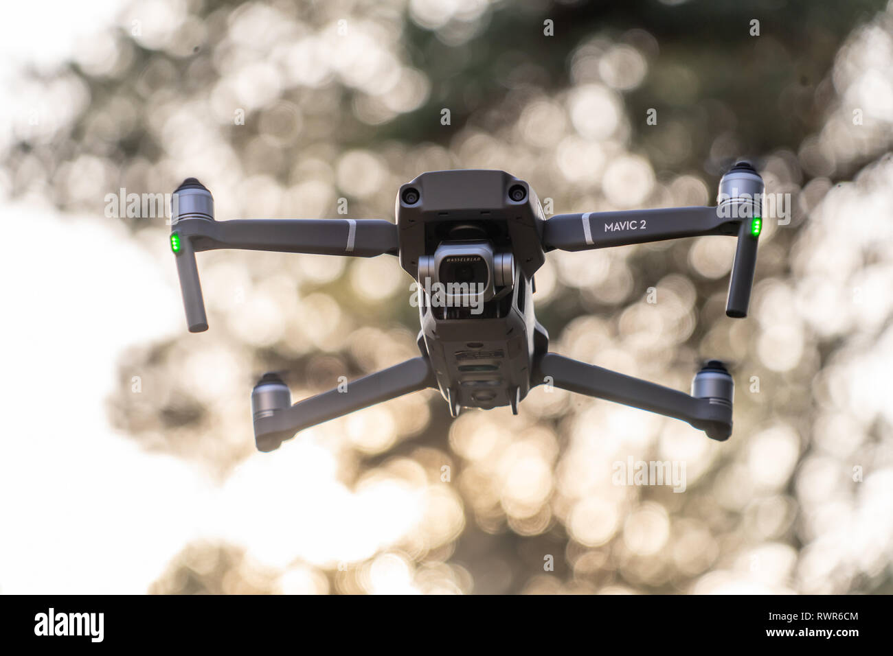 Gifhorn, Germany, February 17., 2019: The hobby drone Mavic 2 pro of a Chinese manufacturer flying in the forest, exempted by reduced depth of field - Stock Image