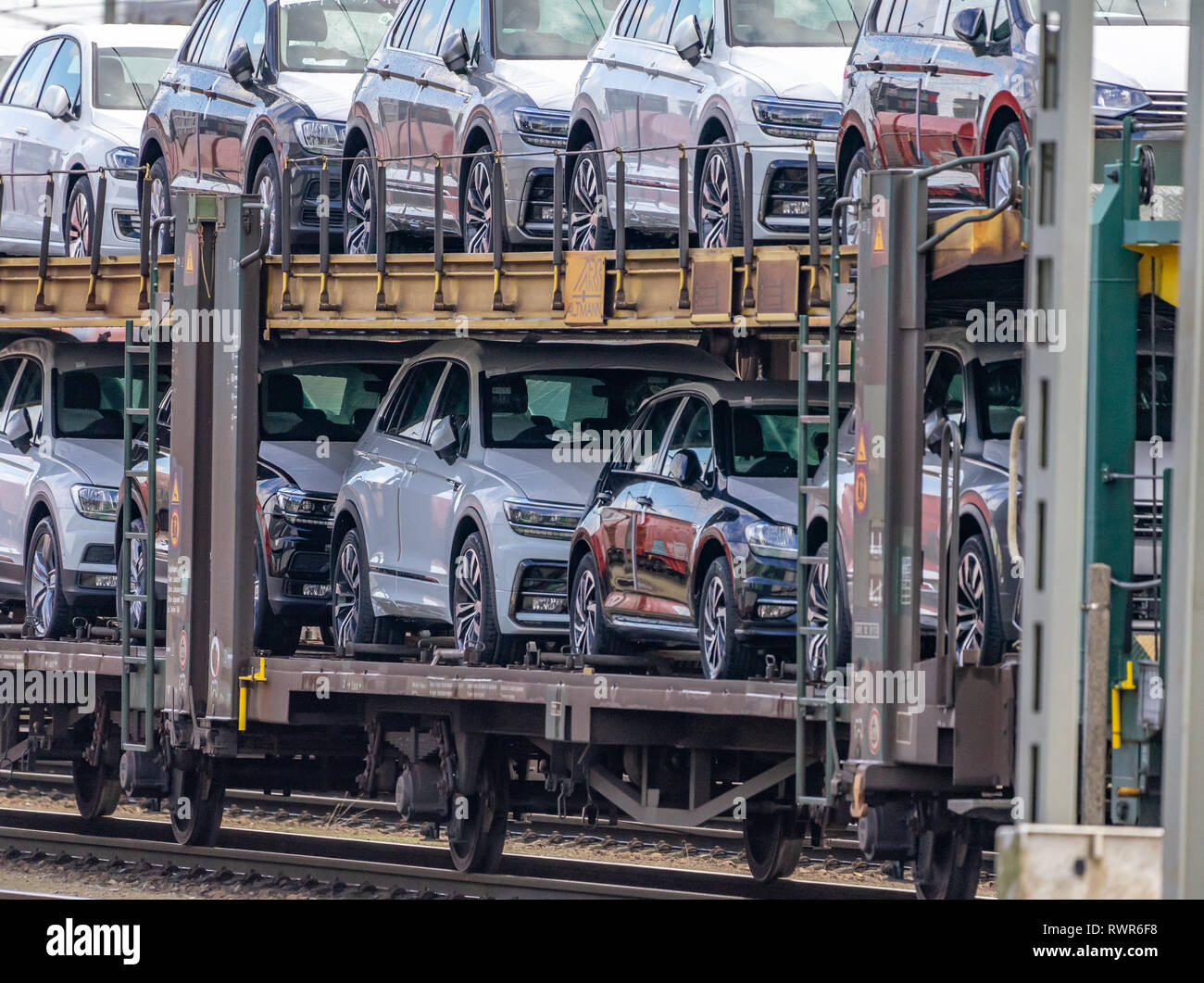 Wolfsburg, Germany, February 5., 2019: Wolfsburg, Germany, February 5., 2019: An open transport wagon with a large number of new Golf Diesel cars are  - Stock Image