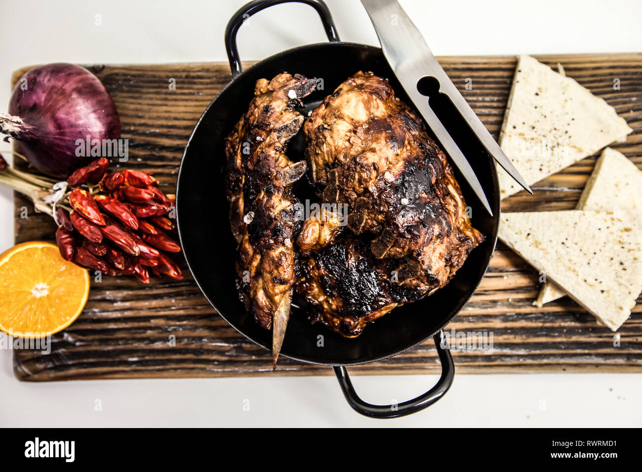 Barbecue pork spare ribs as top view on an old wood board Stock Photo