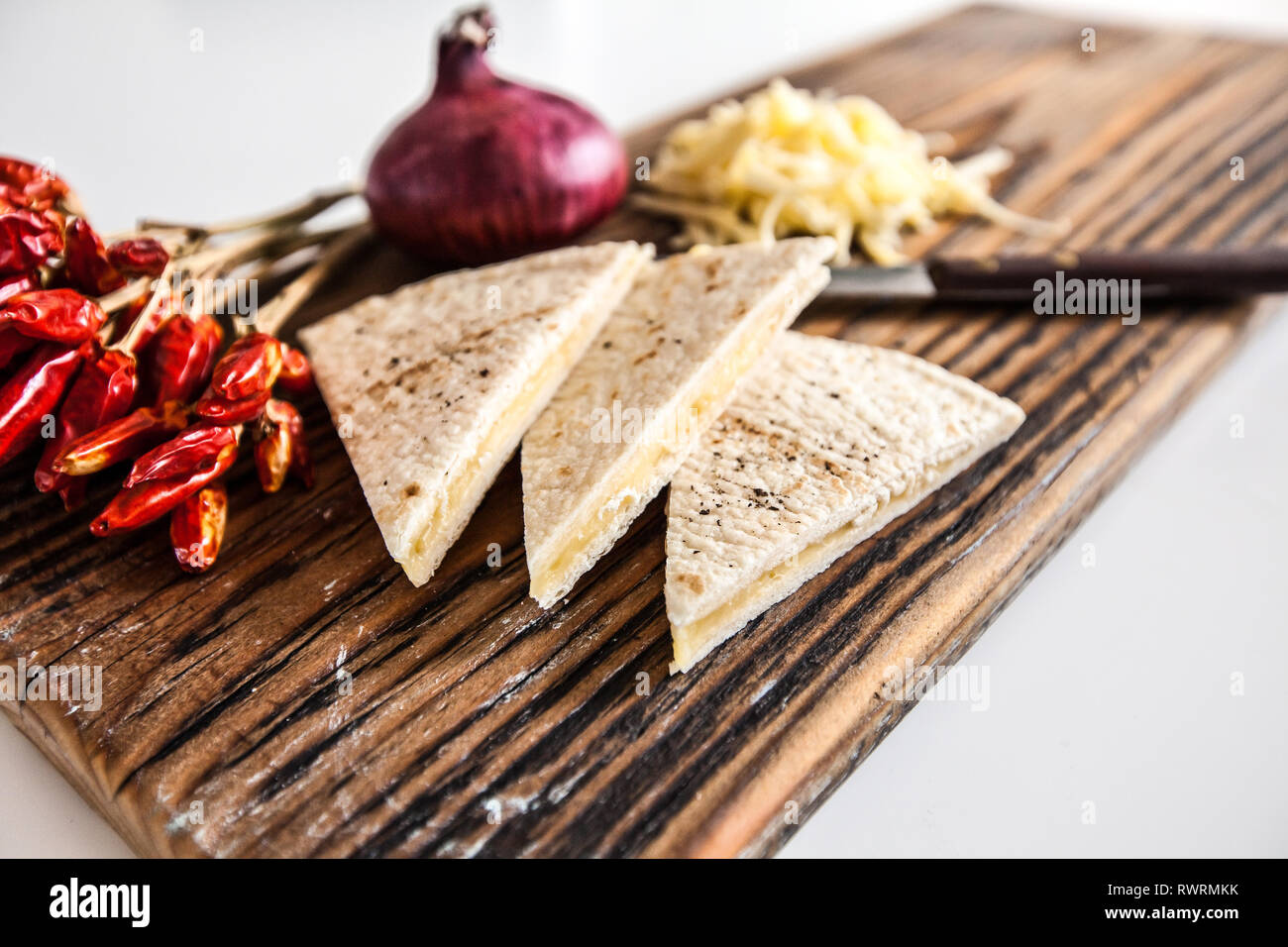 Quesadillas with cheddar and chili on a wood board Stock Photo