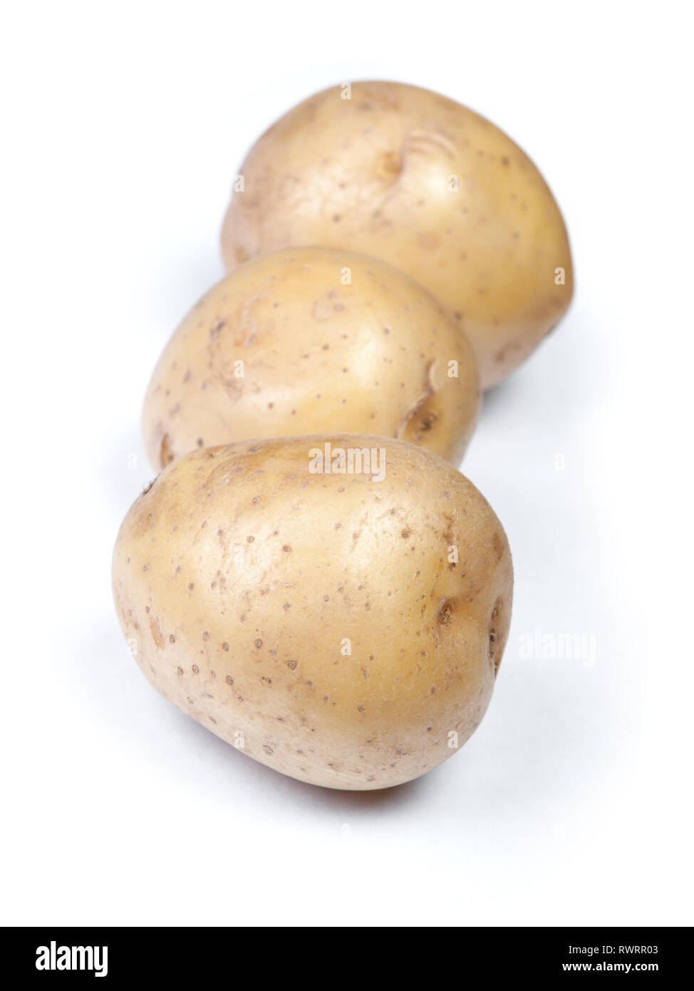 Heap of flawed natural potatoes isolated on white background Stock Photo