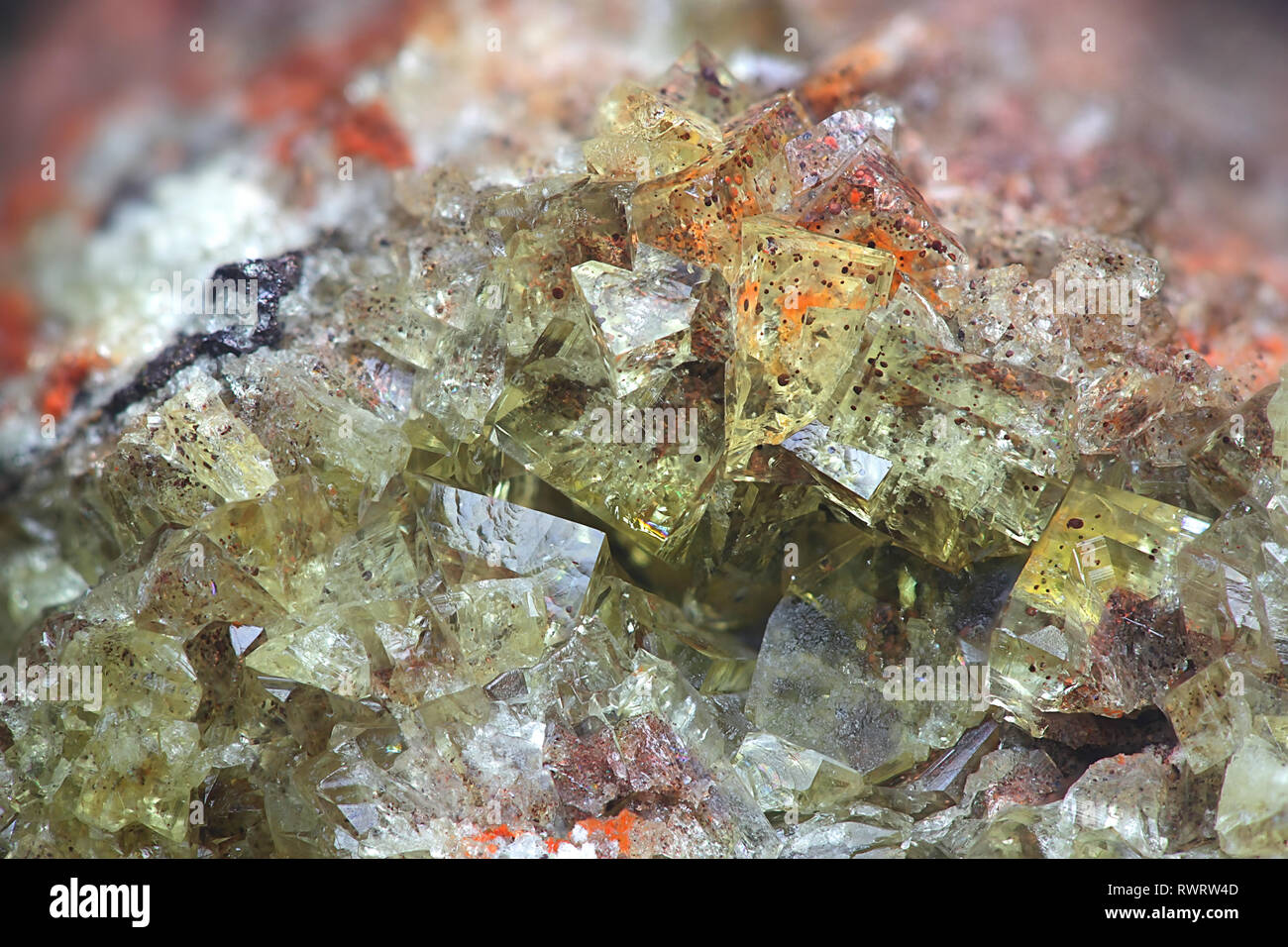 Crystals of fluorite with hematite inclusions from Illo calcite quarry in Finland - Stock Image