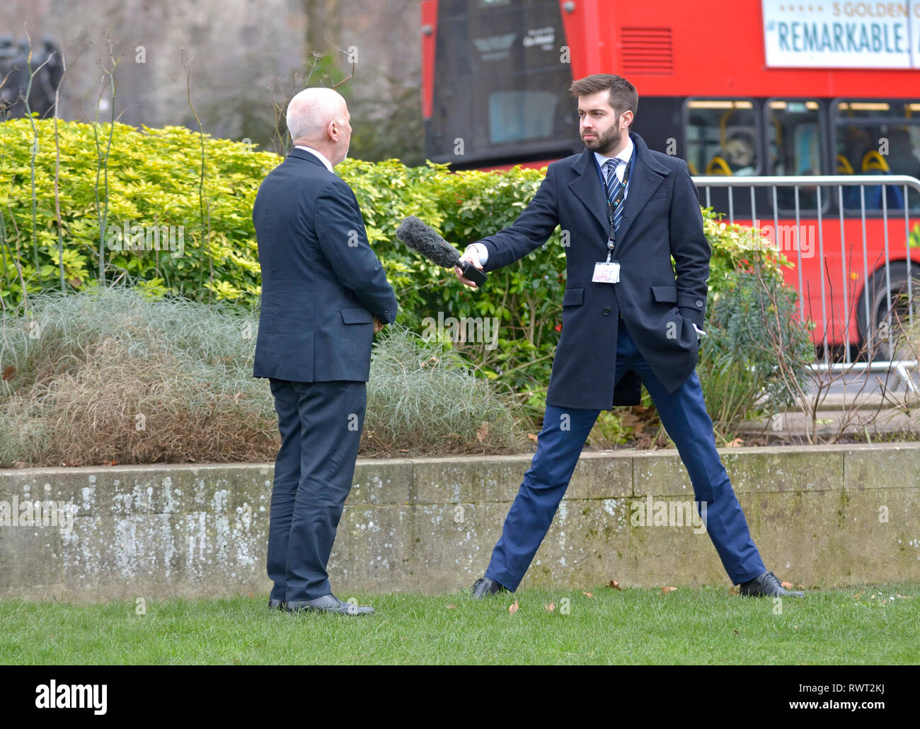 Joe Pike - ITV Political Correspondent for 'The North' - interviewing someone shorter than himself on College Green, Westminster, London, UK. Stock Photo