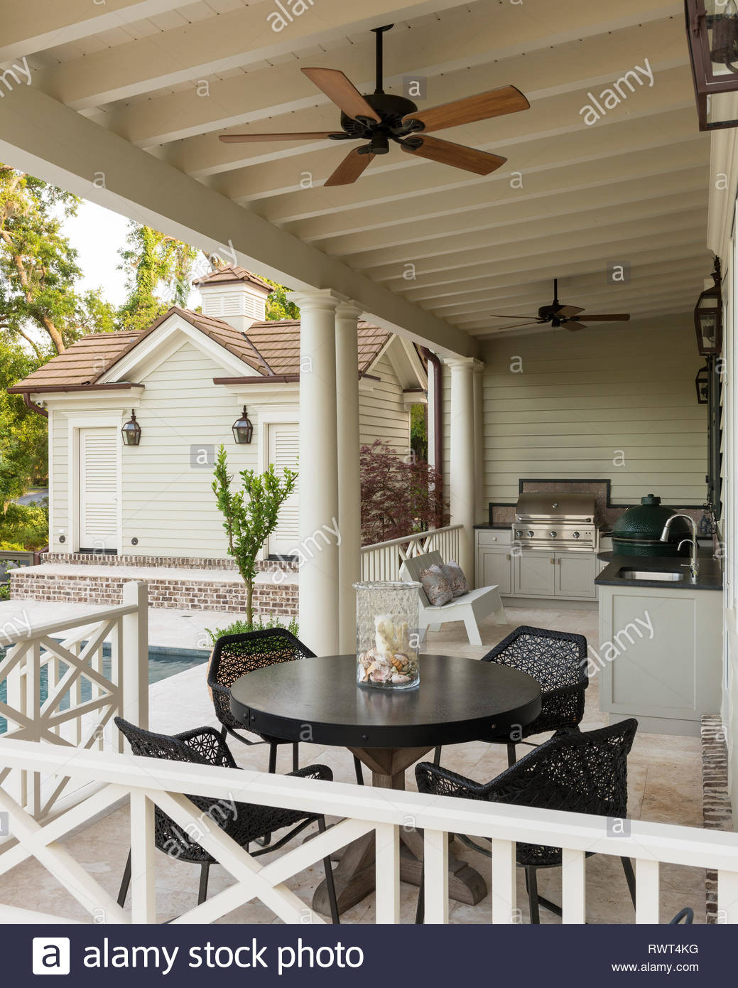Dining and barbecue area on veranda - Stock Image