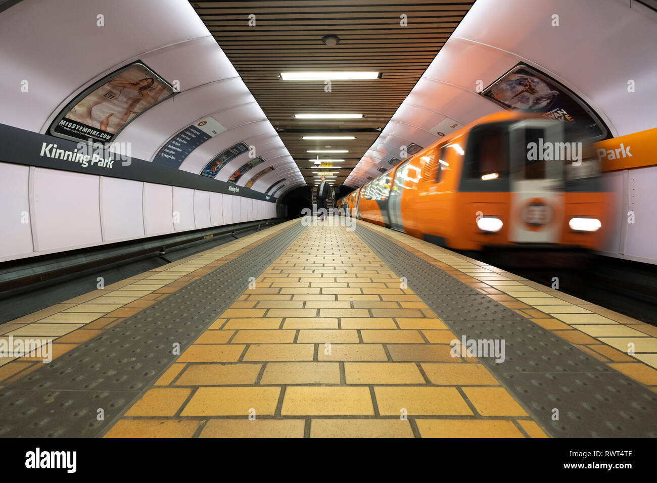 View of platform and train inside station on the Glasgow Subway system in Glasgow, Scotland UK - Stock Image