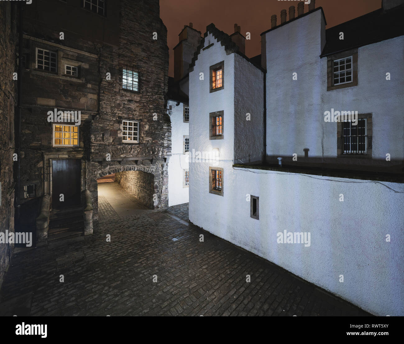 Night view of Bakehouse Close on Royal Mile in Edinburgh, Scotland UK. Location of Outlander as fictional Carfax Close. Scotland ,UK - Stock Image