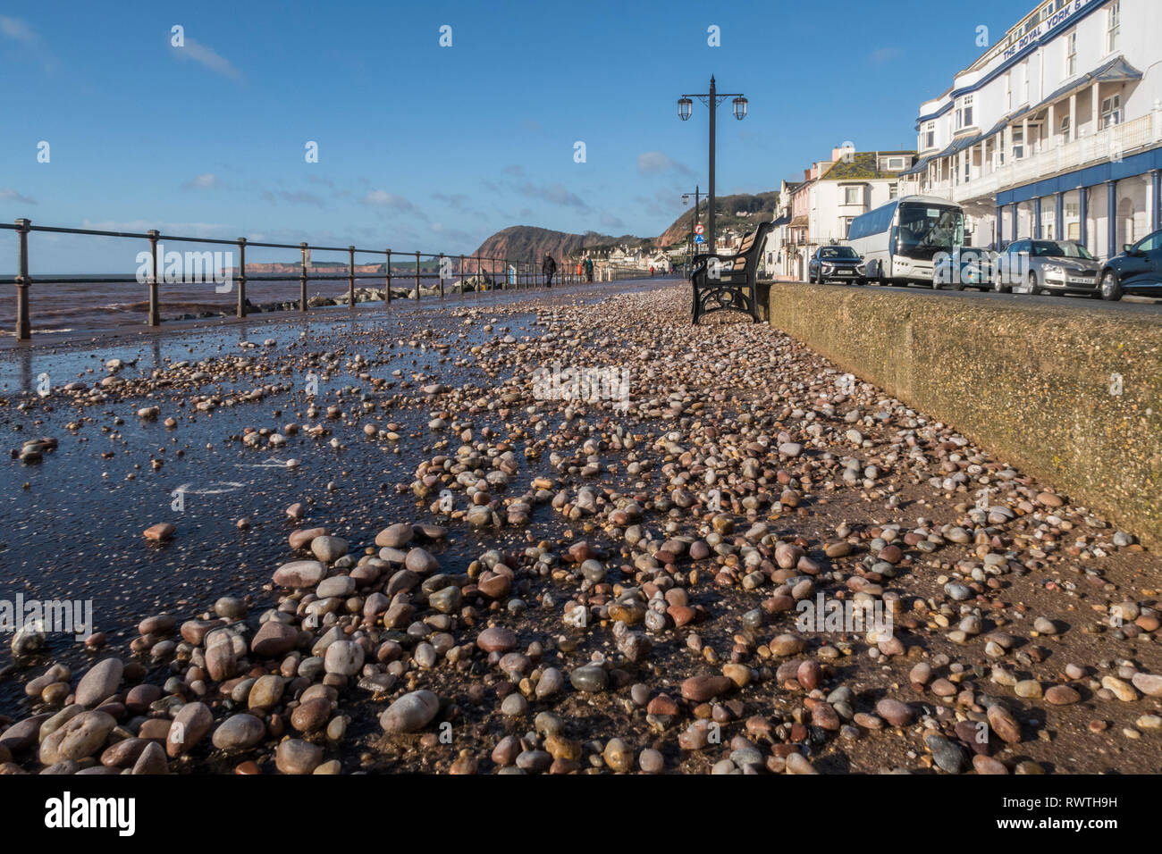 Pebble and shale from the beach thrown onto the seafront Esplanade at Sidmouth by a storm. Stock Photo