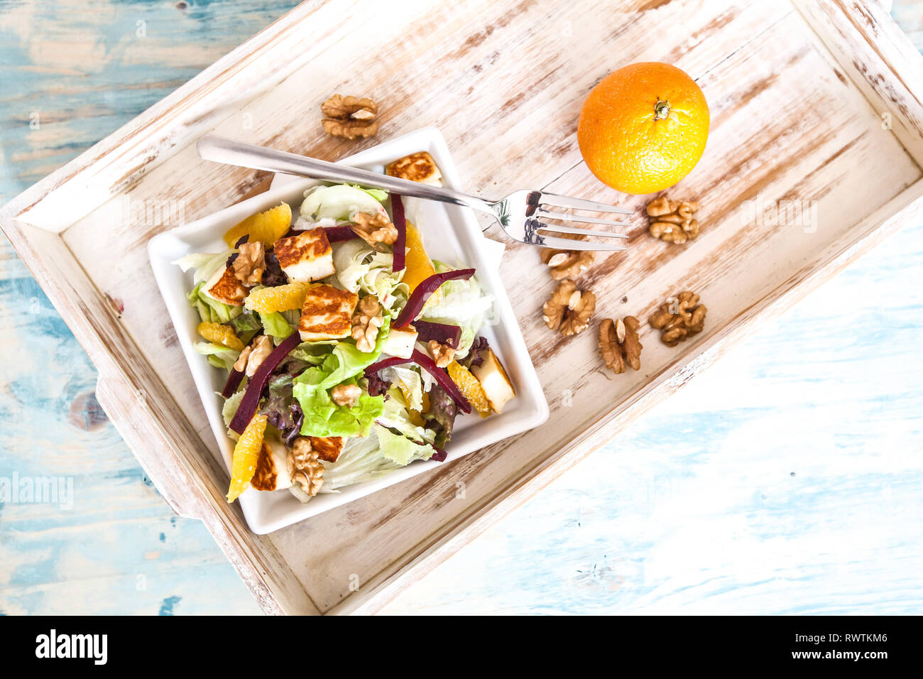 Rocket with orange and beetroot salad on a wood board Stock Photo