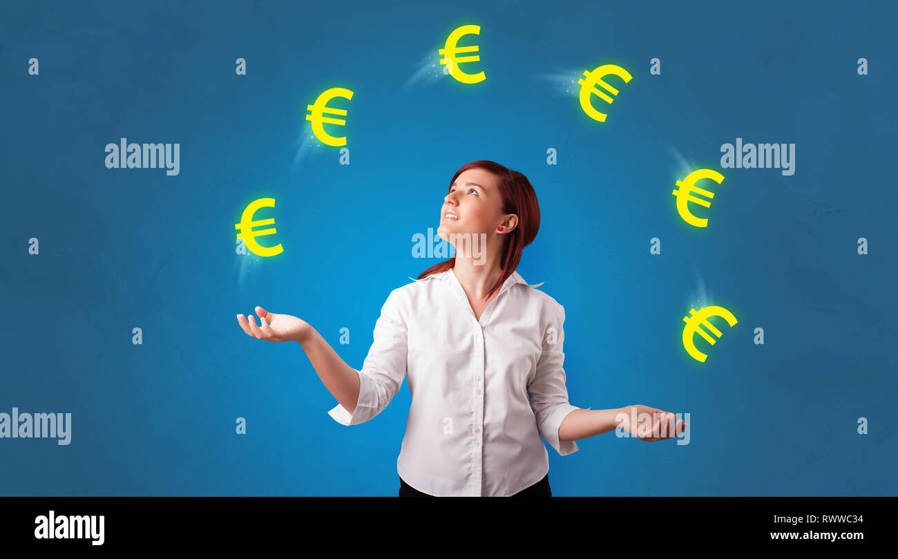 Young happy person juggle with euro symbol  - Stock Image