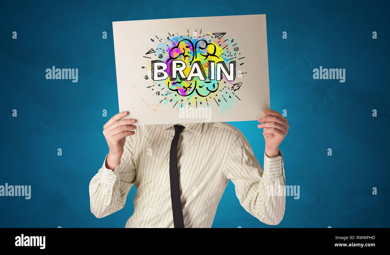 Young person holding white paper in front of her head with colorful brain concept  - Stock Image