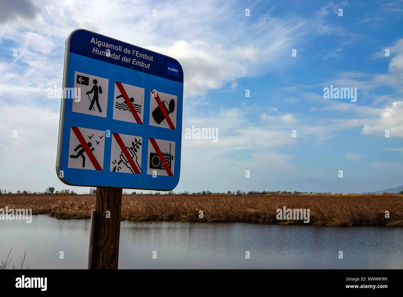 Sign and Wide open spaces, lakes and reed-beds, The Ebro Delta nature reserve, near Amposta, Catalunya, Spain Stock Photo